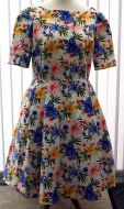 White tropical dress with sleeves and pockets